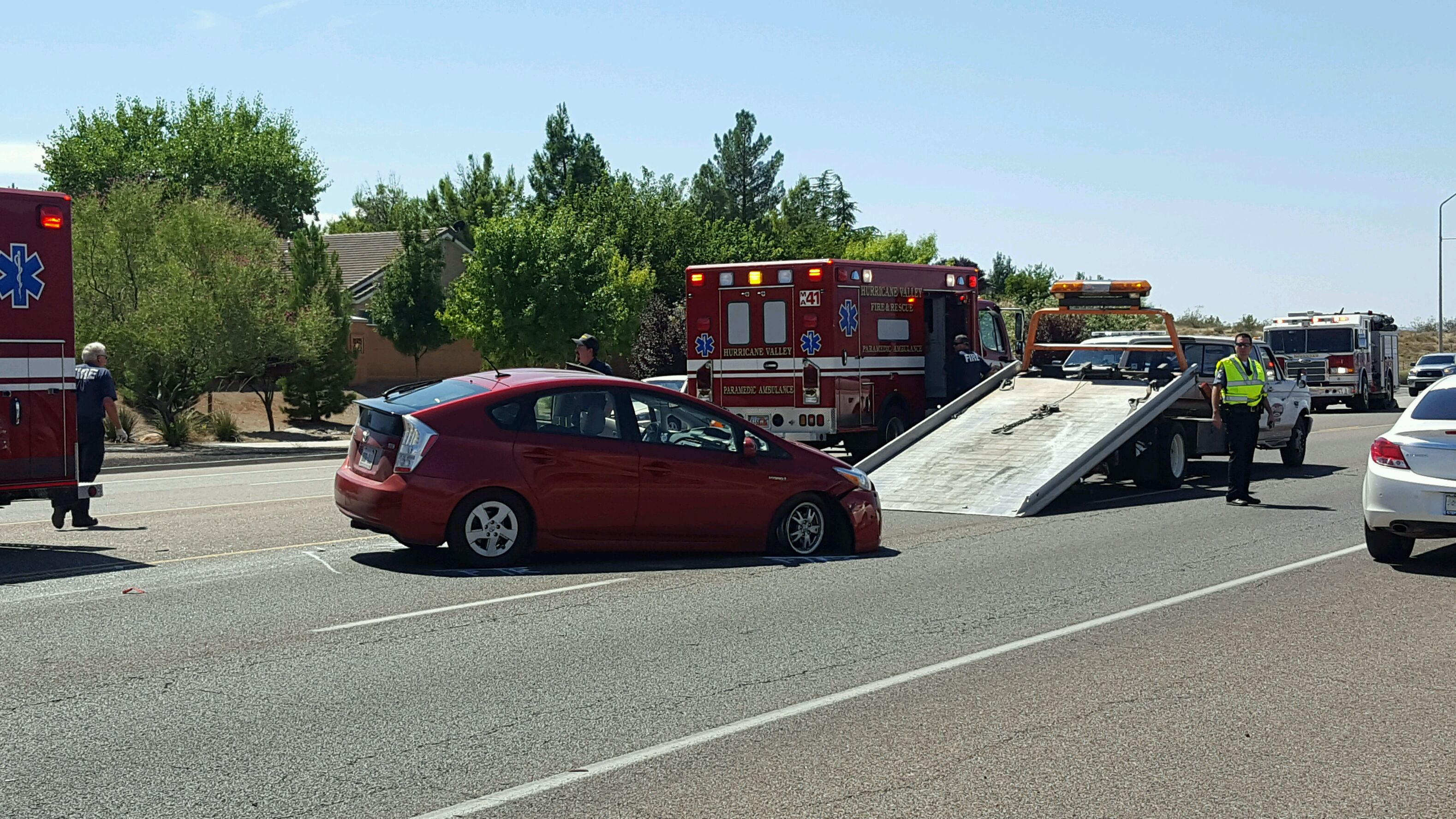 A Toyota Prius is readied to be pulled onto a tow truck after a wreck at 200 West State Street in Hurricane, Utah, Aug. 30, 2016 | Photo courtesy of Sgt. Brandon Buell, Hurricane City Police, St. George News