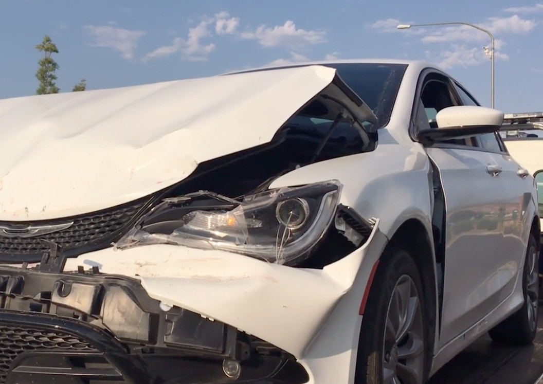 A rear-end collision Thursday morning at River Road and 1450 South caused heavy damage to a Chrysler involved in the crash, St. George, Utah, Aug. 25, 2016 | Photo by Mike Cole, St. George News