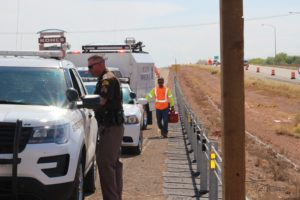 Responders line up in the right hand emergency lane with Todd Royce from UDOT bringing gas for the Jeep on Interstate 15 in Washington, Utah, Aug. 18, 2016 | Photo by Cody Blowers, St. George News