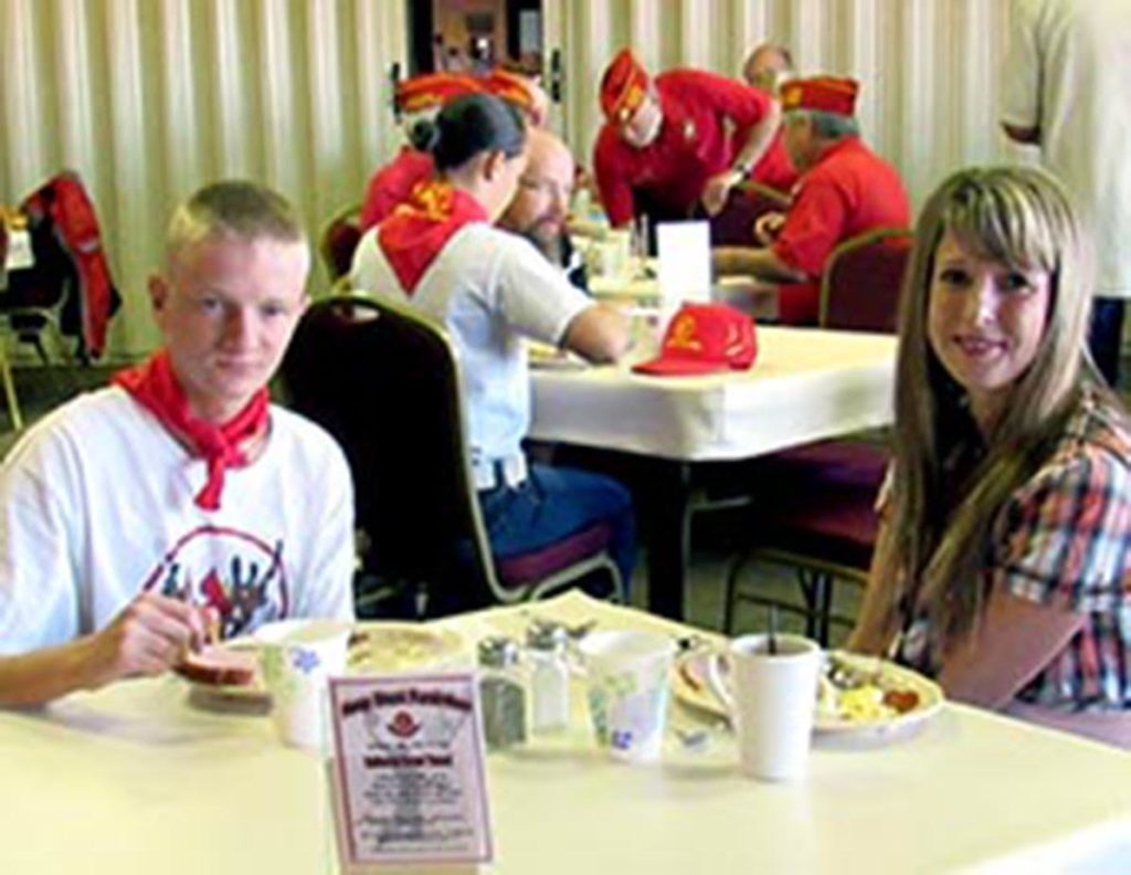 L-R foreground: Braxston Summers enjoys the breakfast at the Elks Lodge with his mother, St. George, Utah, |