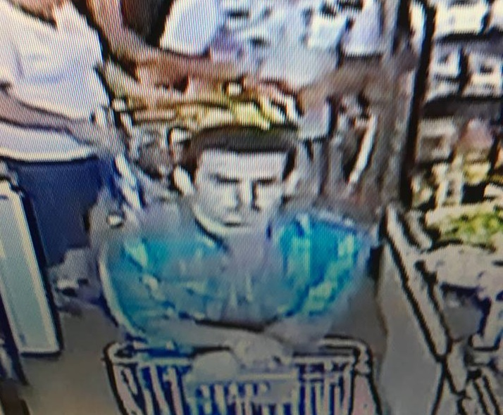 This photo released by St. George Police Department shows a man police are looking for in connection with an alleged stolen credit card used at stores in St. George and Washington City. Police indicate this is a security camera image from July 14, 2016 | Photo courtesy of the St. George Police Department, St. George News