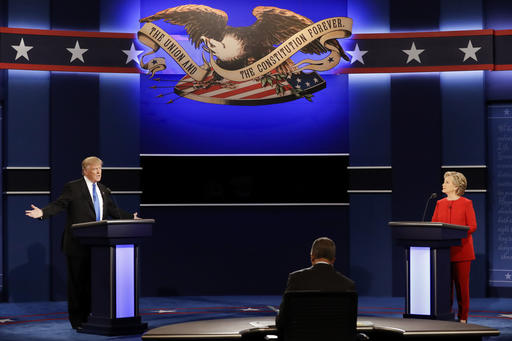 Republican presidential nominee Donald Trump answers a question as Democratic presidential nominee Hillary Clinton listens during the presidential debate at Hofstra University in Hempstead, N.Y., Monday, Sept. 26, 2016 | AP Photo/David Goldman, St. George News