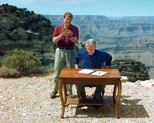 FILE – In this Sept. 18, 1996, file photo, Vice President Al Gore applauds after President Bill Clinton signs a bill designating about 1.7 million acres of land in Southern Utah's red-rock cliff as the Grand Staircase-Escalante National Monument, at the Grand Canyon National Park, in Arizona. As Utah waits to see if President Barack Obama will designate a new national monument in the state, the 20th anniversary of the Grand Staircase Escalante-National Monument rekindled memories of an event that ignited simmering western frustrations about federal ownership of public land, Grand Canyon National Park, Arizona, Sept. 18, 1996 | AP Photo/Doug Mills, St. George News