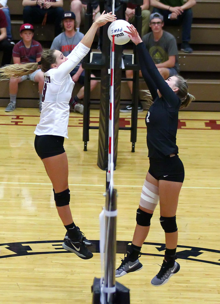 Pine View's Amelia Goebel (19) and Desert Hills' Hailee Harmer (2), Pine View vs. Desert Hills, Volleyball, St. George, Utah, Sept. 27, 2016, | Photo by Robert Hoppie, ASPpix.com, St. George News
