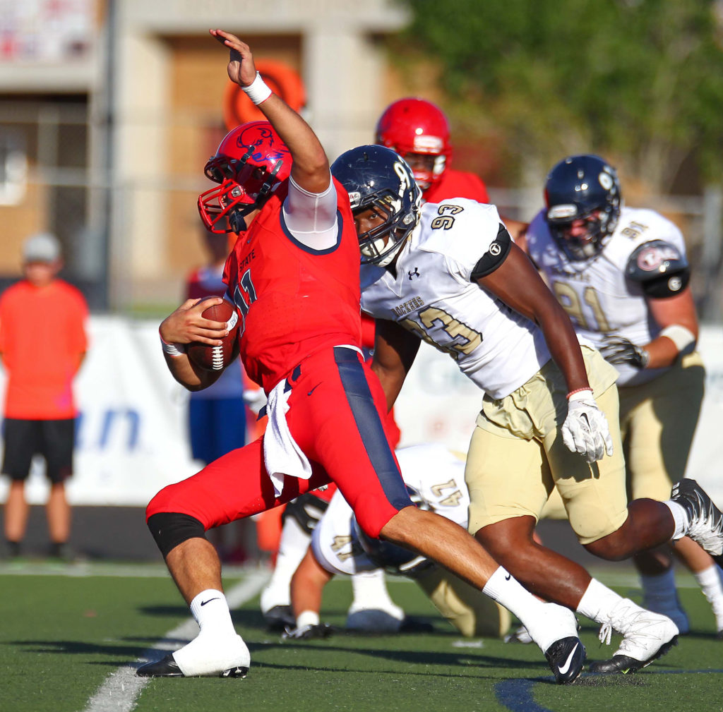 Dixie State's Tyson Blackner (11), Dixie State University vs. South Dakota State School of Mines & Technology, Football, Grantsville, Utah, Sept. 10, 2016, | Photo by Robert Hoppie, ASPpix.com, St. George News