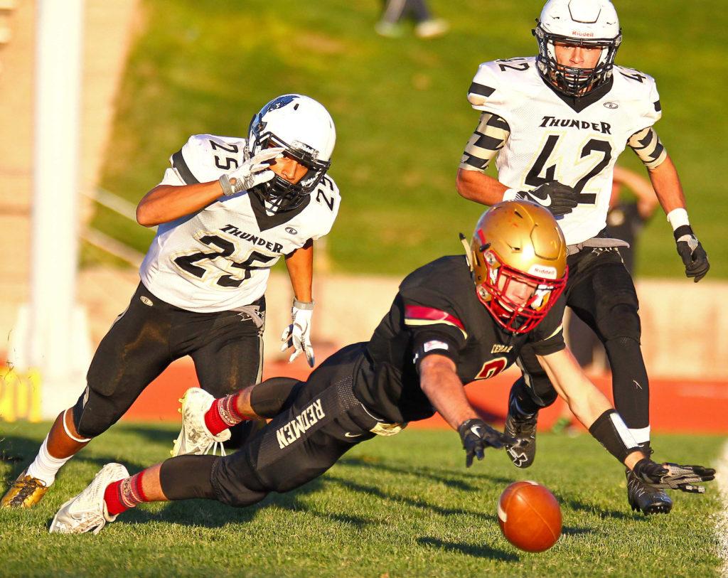 Cedar's Braden Garrett (3) dives for a fumble, Cedar vs. Desert Hills, Football, Cedar City, Utah, Sept. 16, 2016, | Photo by Robert Hoppie, ASPpix.com, St. George News