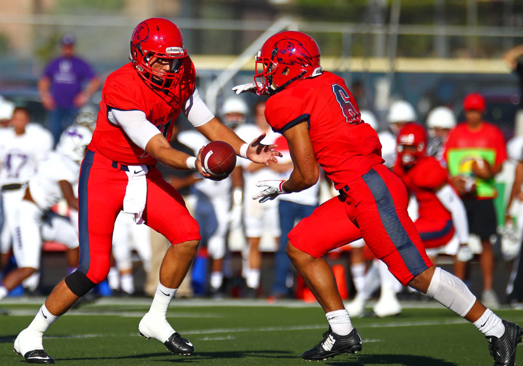 Dixie State's Tyson Blackner (11) hands off to Orlando Wallace (6), Dixie State University vs. New Mexico Highlands University, Football, St. George, Utah, Sept. 1, 2016, | Photo by Robert Hoppie, ASPpix.com, St. George News