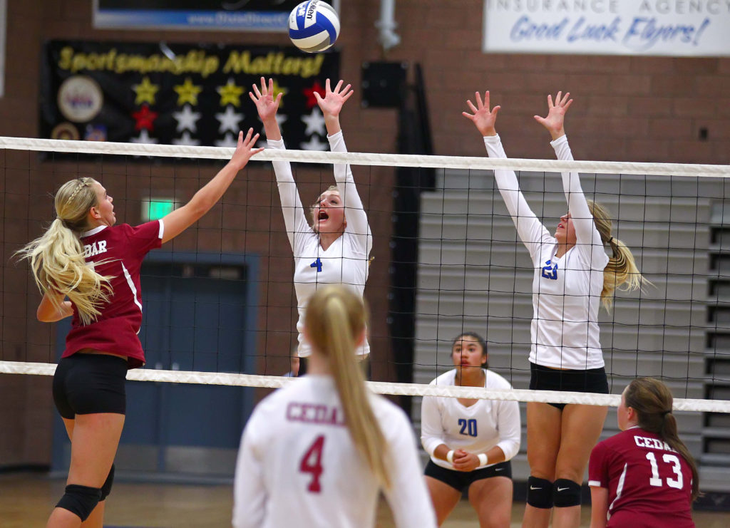 Cedar's Dream Weaver (3) and Dixie's Lauren Beatty (4), Dixie vs. Cedar, Volleyball, St. George, Utah, Sept. 20, 2016, | Photo by Robert Hoppie, ASPpix.com, St. George News