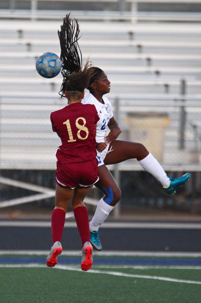 Dixie's Starlee Woodbury (23) and Cedar's Hannah Sobel (18), Dixie vs. Cedar, Soccer, St. George, Utah, Sept. 6, 2016,   Photo by Robert Hoppie, ASPpix.com, St. George News