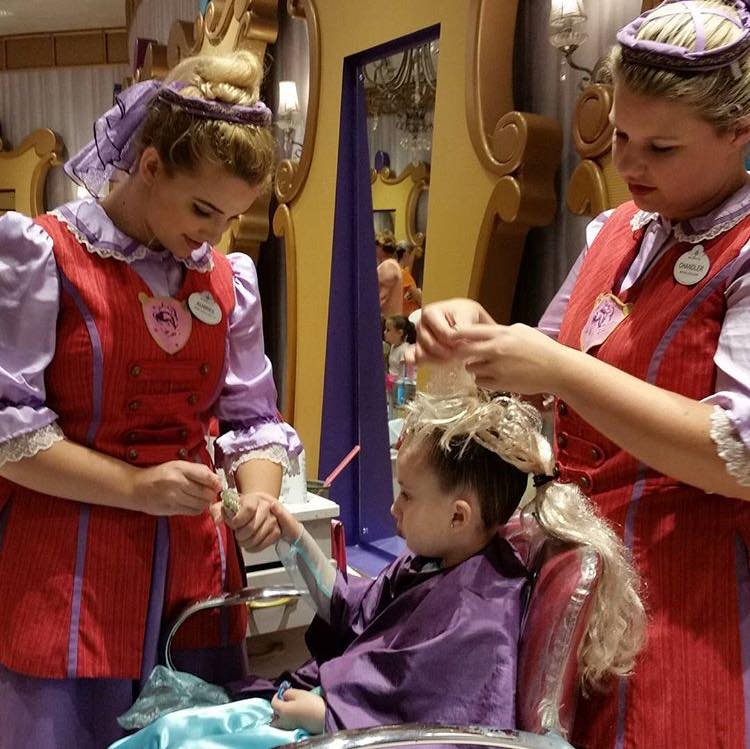 Fairy Godmother-in-Training Aubree Christensen and her counterpart transforming a little girl into a princess, Walt Disney World, Orlando, Florida, Nov. 24, 2015 | Photo courtesy of Aubree Christensen, St. George News