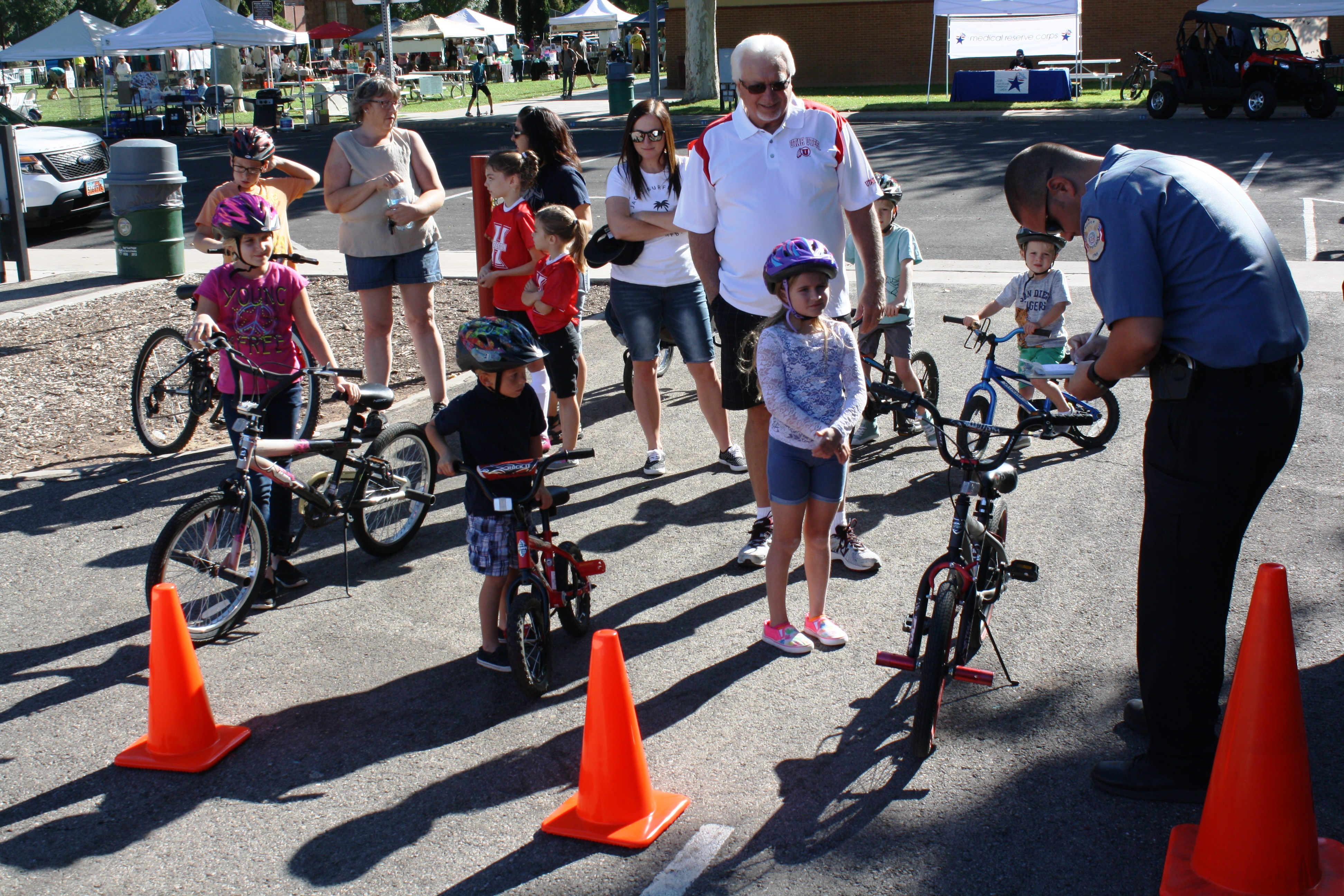 Hurricane City Police Officers do safety checks on children's bicycles at the Awareness and Preparedness Fair, Hurricane, Utah, Sept. 10, 2016 | Reuben Wadsworth, St. George News