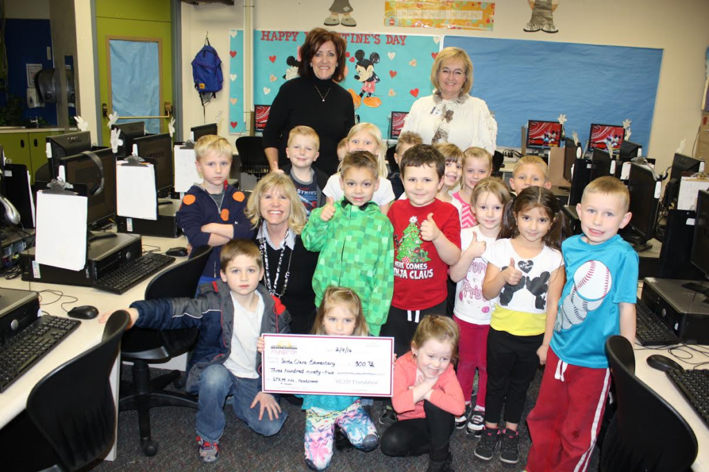 Washington County School District Foundation Director, Pam Graf (black shirt) presents a check to Santa Clara Elementary, Santa Clara, Utah, date not specified | Photo courtesy of Pam Graf, St. George News