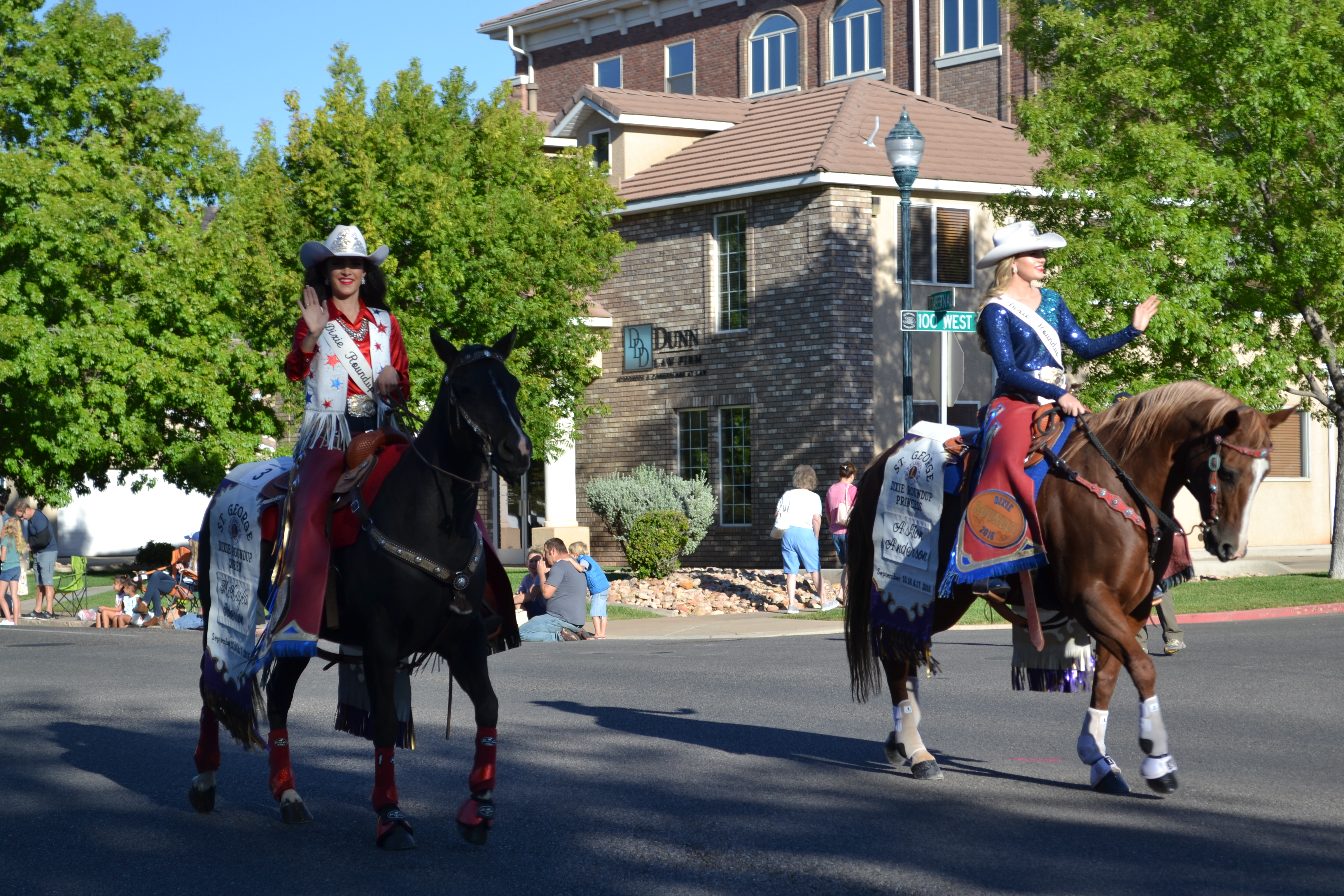 Dixie Roundup Queen McKayla Jimmerson and Princess Ashton Anderson ride horseback along the parade route, St. George, Utah, Sept. 17, 2016 | Photo by Joseph Witham, St. George News
