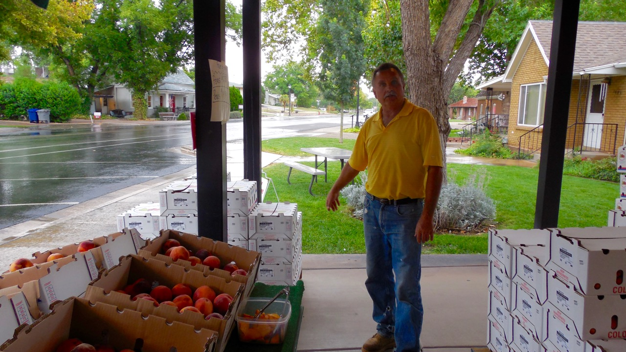 Bryce Frei shows off boxes of fresh peaches at Frei's Fruit Market, Santa Clara, Utah, Sept. 1, 2016 | Photo by Julie Applegate, St. George News