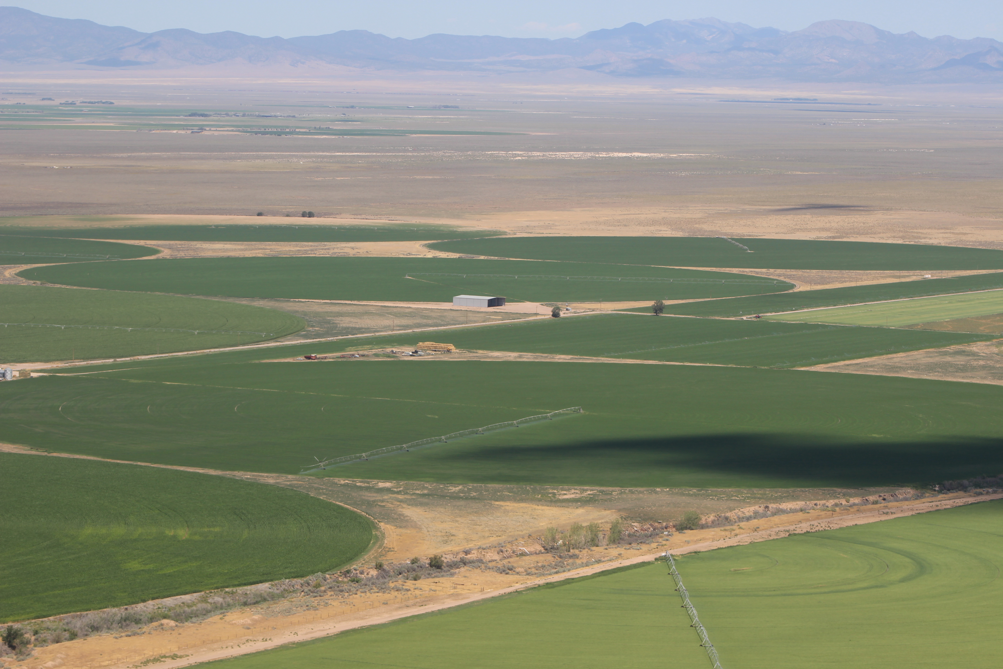 Crop circles where farmers grow their goods dot the landscape on the west end of Iron County. Iron County, Utah, July 15, 2016 | Photo by Tracie Sullivan, St. George News / Cedar City News