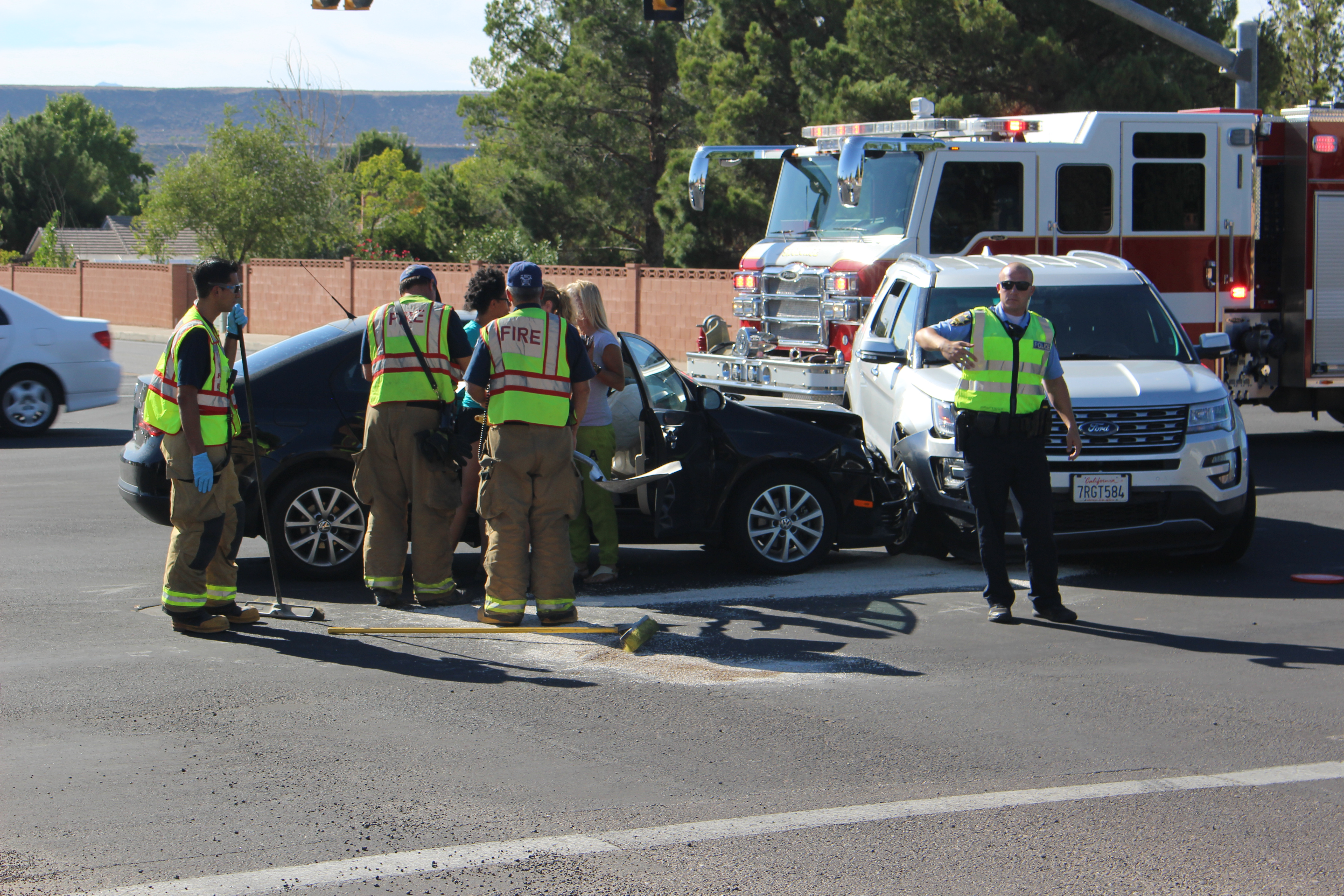 Two cars in the middle of the River Road and Riverside Drive intersection after a collision Monday. St. George, Utah, Sept. 6, 2016 | Photo by Ric Wayman, St. George News