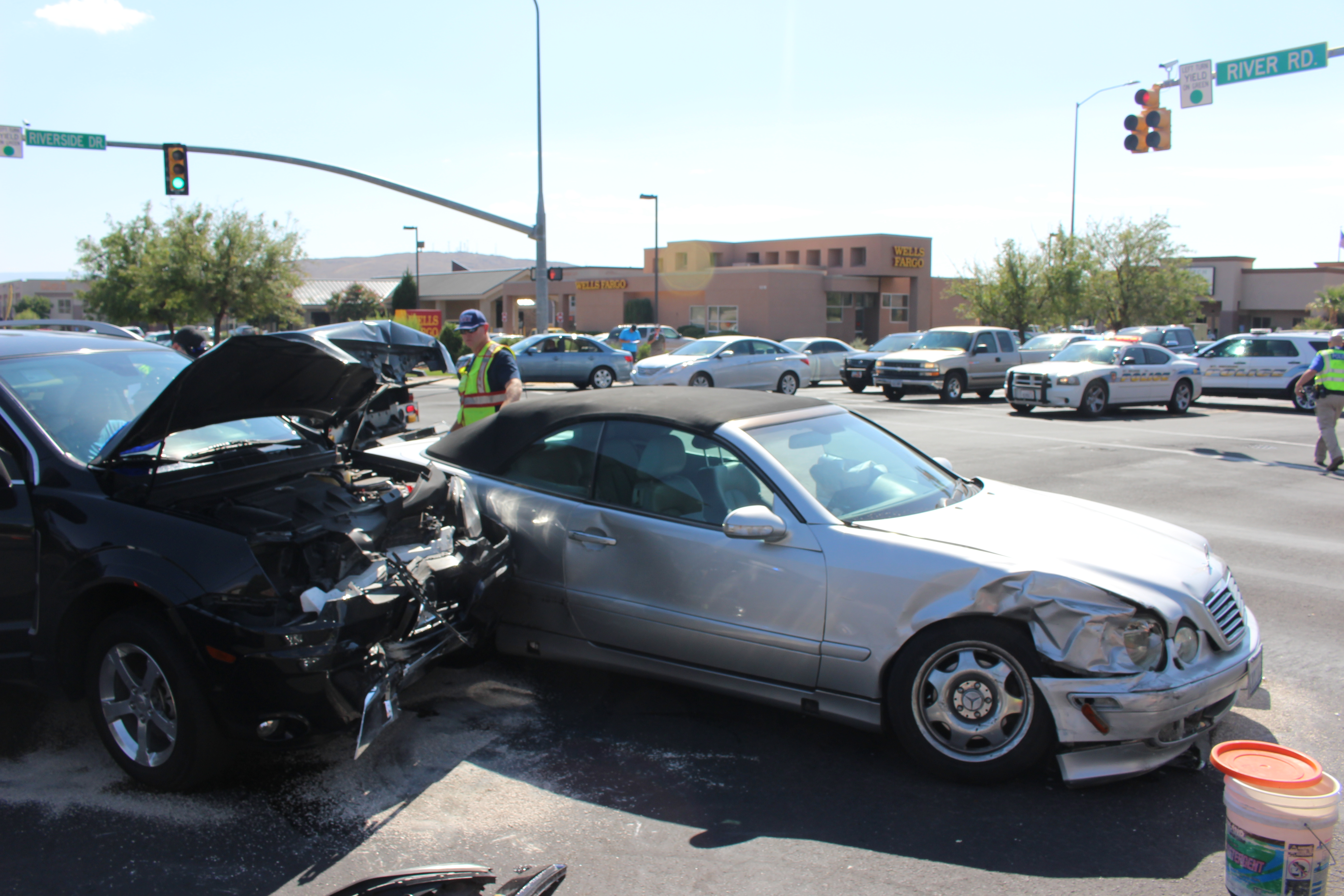 Two cars sit disabled in the intersection of Riverside Drive and River Road Monday after a crash that caused both drivers to be taken to the hospital. St. George, Utah, Sept. 12, 2016 | Photo by Ric Wayman, St. George News
