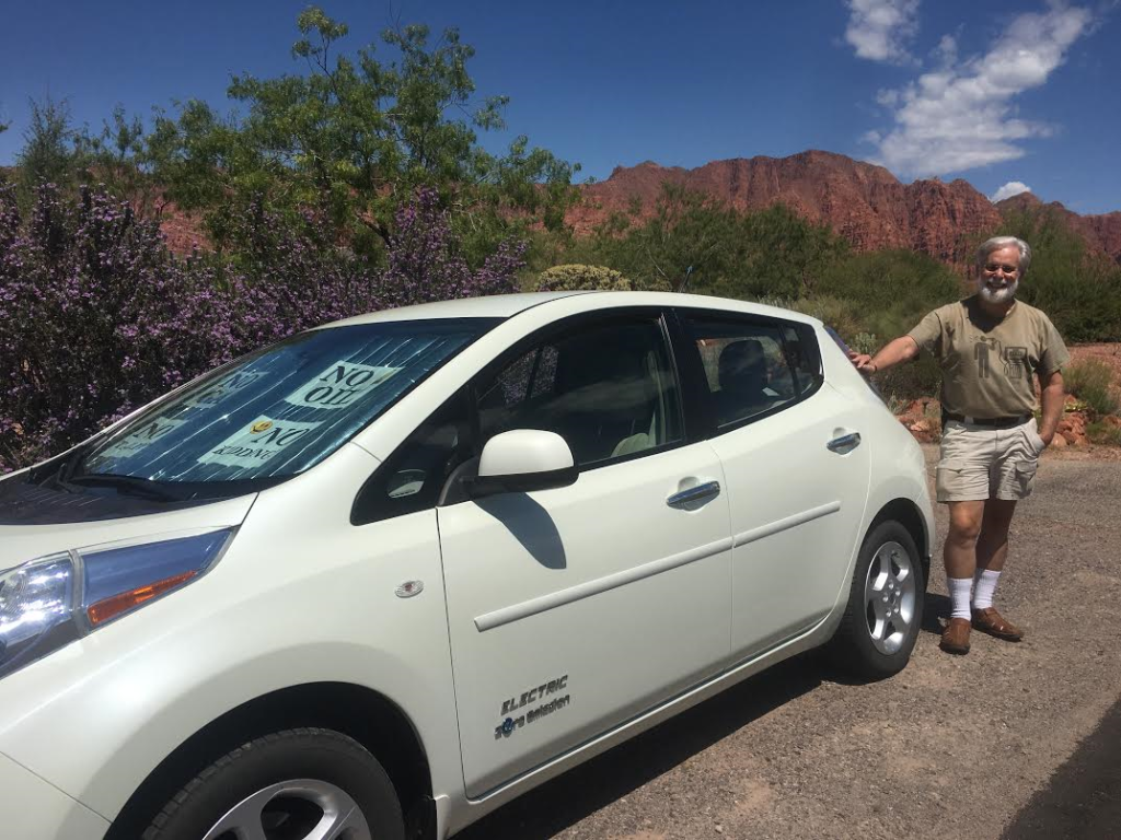 Kayenta resident and Nissan Leaf owner, Mark Larsen, poses with his vehicle in Ivins, Utah, August 15, 2016 | Photo by Hollie Reina, St. George News