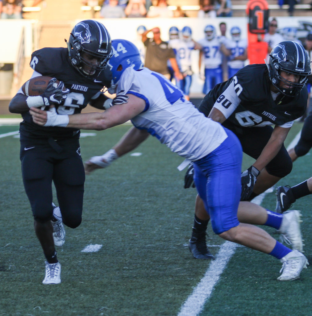 Pine View's Jacob Mpungi (6), and Dixie's Kaden Williams (44), Pine View vs. Dixie, Football, St. George, Utah, Sep.16, 2016, | Photo by Kevin Luthy, St. George News