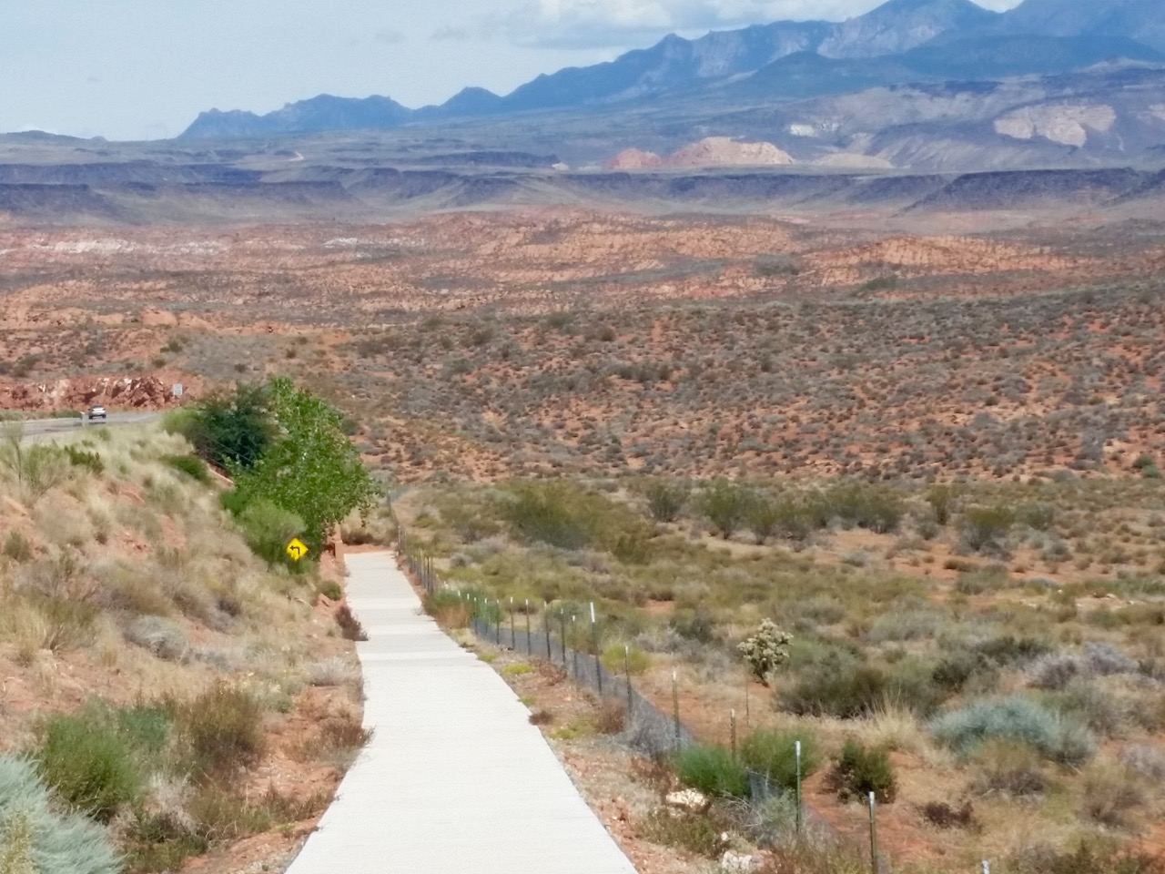 """Red Hills Parkway, known to old-timers as """"Turtle Road,"""" is visible in the far left of the photograph. The Red Cliffs National Conservation Area lies adjacent to much of the population of Washington County, St. George, Utah, Aug. 29, 2015   Photo by Julie Applegate, St. George News"""
