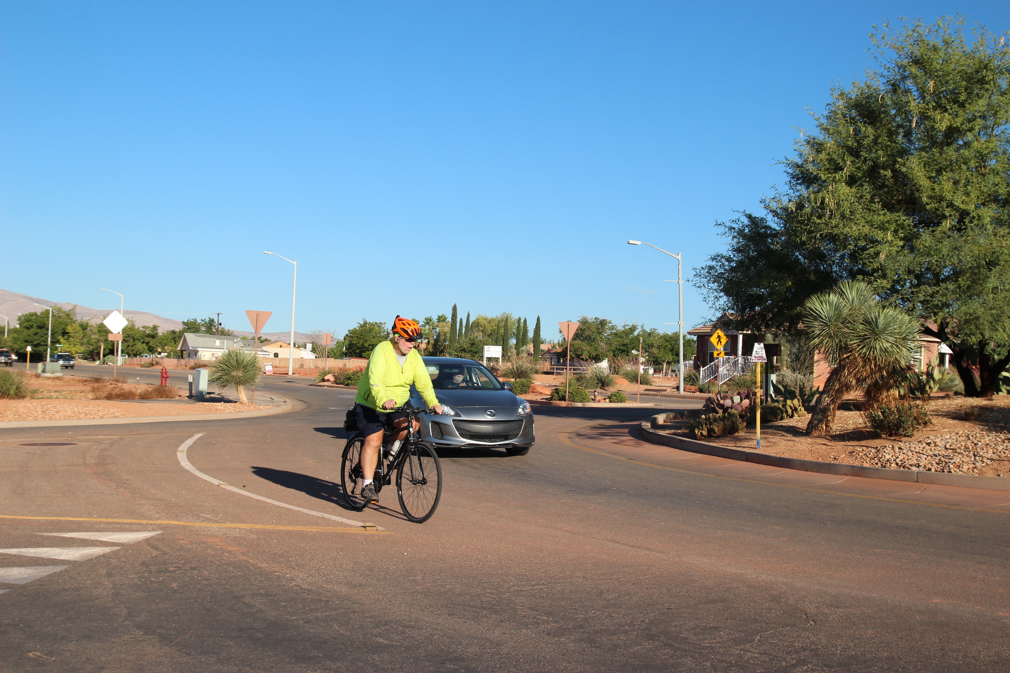 Tim Tabor rides through the roundabout at Center Street and 200 East in Ivins. Tabor is riding straight through. He is positioned within the lane, making him more visible to any vehicle that might enter to his right (from entrance point at bottom left of photo) and to the vehicle behind him. Ivins, Utah, Aug. 31, 2016 | Photo courtesy of Tim Tabor, St. George News