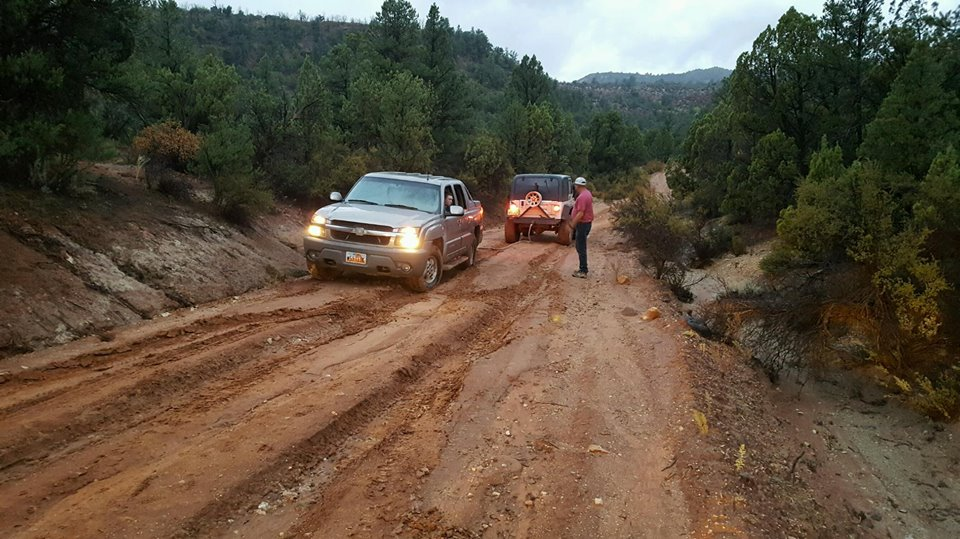Search and rescue personnel help extricate a couple who got stuck in the mud on Danish Ranch Road, Washington County, Utah, Sept. 22, 2016 | Photo courtesy of Washington County Search and Rescue, St. George News