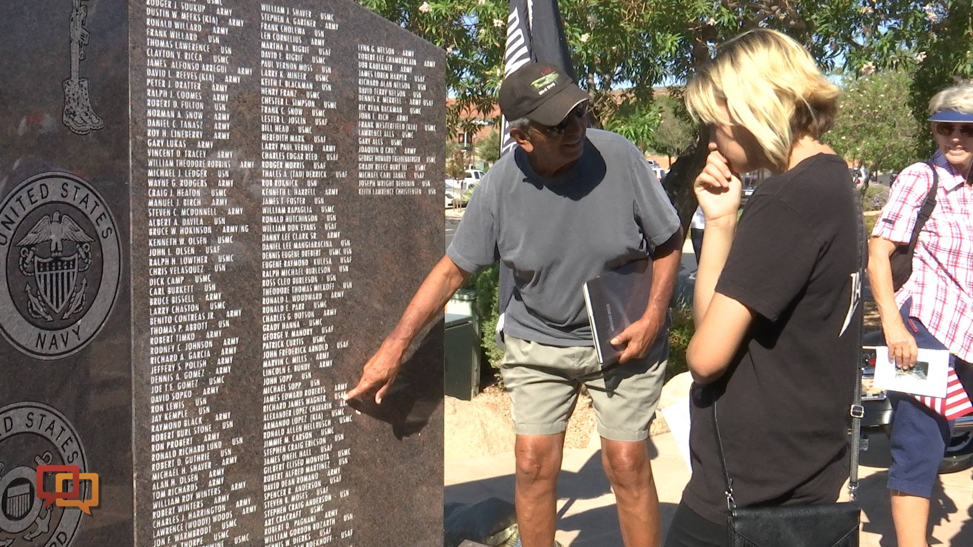 A veteran points to a name on the Vietnam Veterans monument following the Vietnam Veterans Monument dedicatory ceremony at Zion Harley Davidson, Washington City, Utah, September 10, 2016 | Photo by Sheldon Demke, St. George News