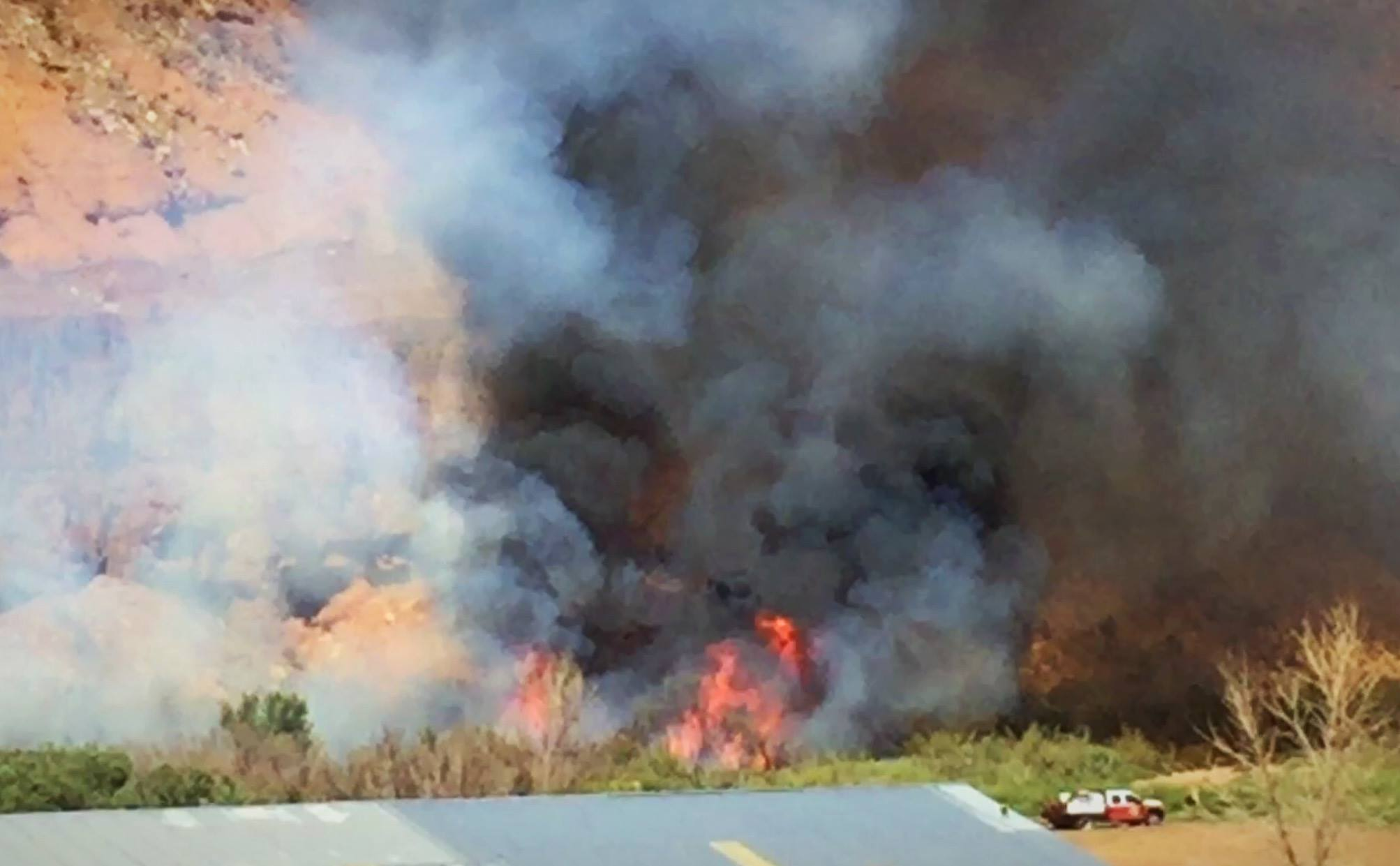 A farmer's controlled burn quickly spread out of control making its way to the south edge of the Virgin River in an area just north of 800 S. 1900 East, Washington City, Utah, Sept. 8, 2016 | Photo by Kimberly Scott, St. George News