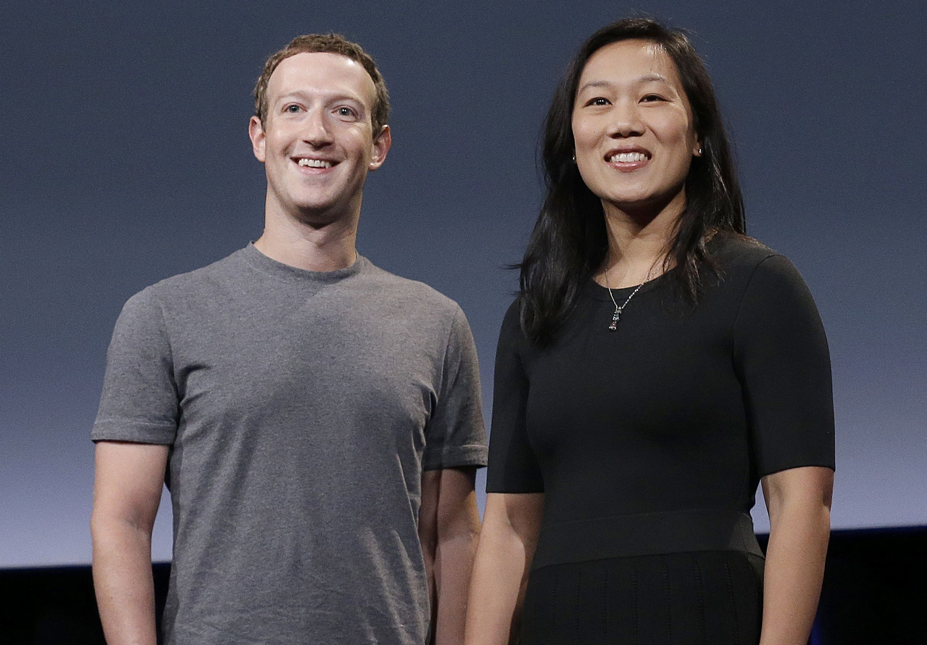 In this Tuesday photo, Facebook CEO Mark Zuckerberg and his wife, Priscilla Chan, smile as they prepare for a speech in San Francisco. Zuckerberg and Chan have a new lofty goal: to cure, manage or eradicate all disease by the end of this century. To this end, the Chan Zuckerberg Initiative, the couple's philanthropic organization, is committing significant financial resources over the next decade to help accelerate basic science research. San Franciso, Calif., Sept. 20, 2016 | AP Photo/Jeff Chiu, St. George News