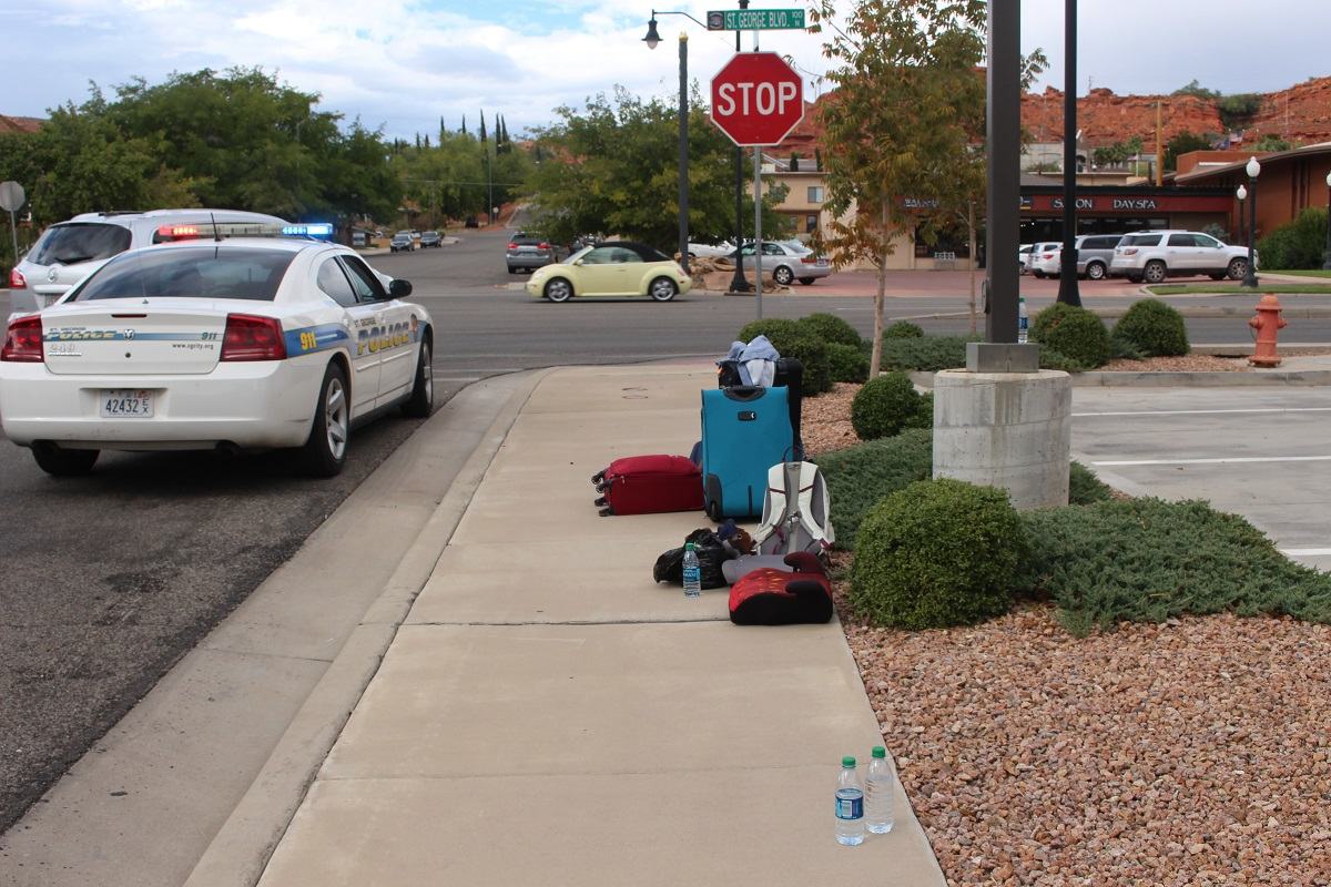 The family's luggage was taken from the rented Jeep and placed on East 100 while they waited for a cab after a two-car collision on St. George Boulevard Wednesday, St. George, Utah, Sept. 28, 2016 | Photo by Cody Blowers, St. George News