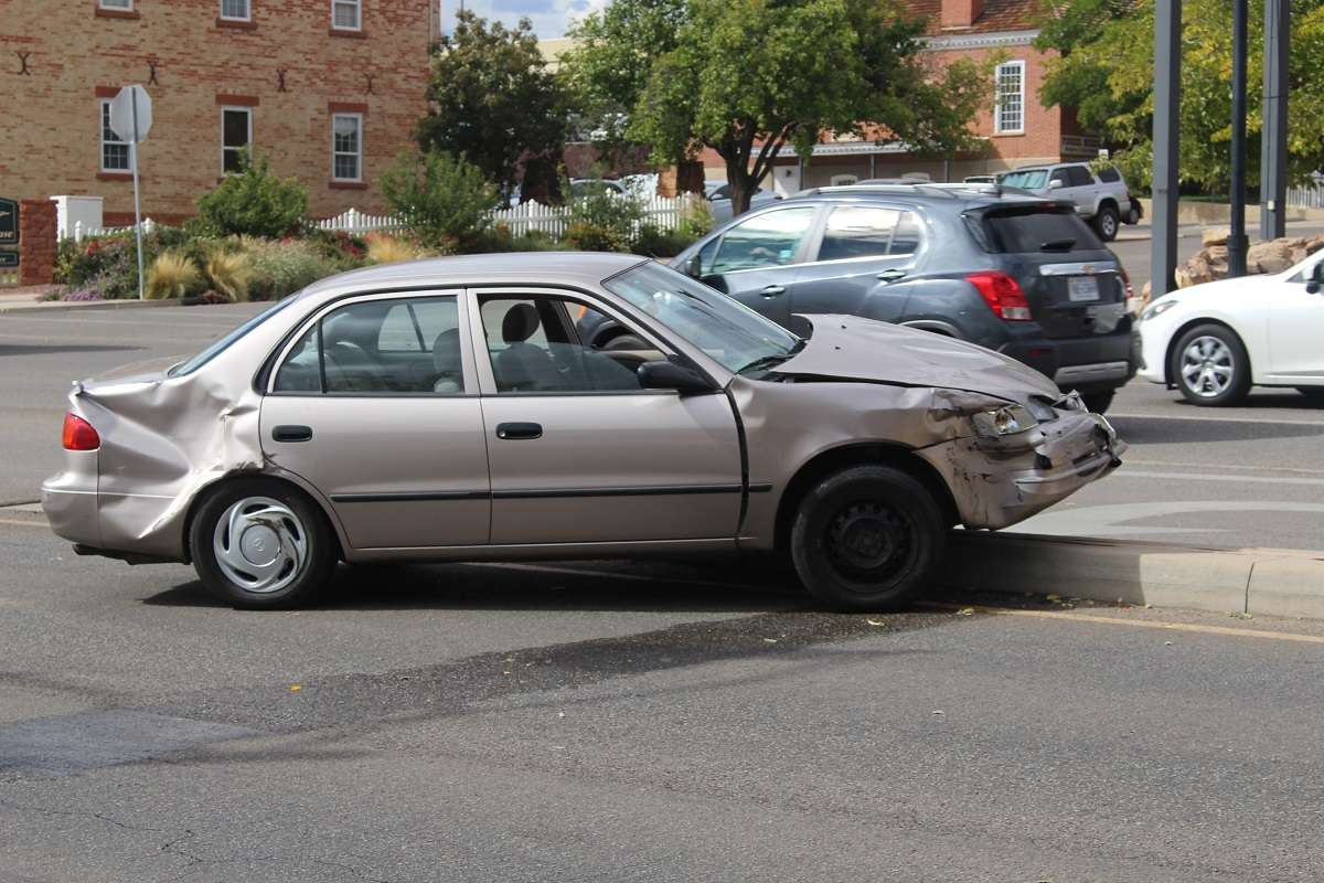A gold Toyota Corolla was launched onto the center median after a two car collision on St. George Boulevard, St. George, Utah, Sept. 28, 2016 | Photo by Cody Blowers, St. George News