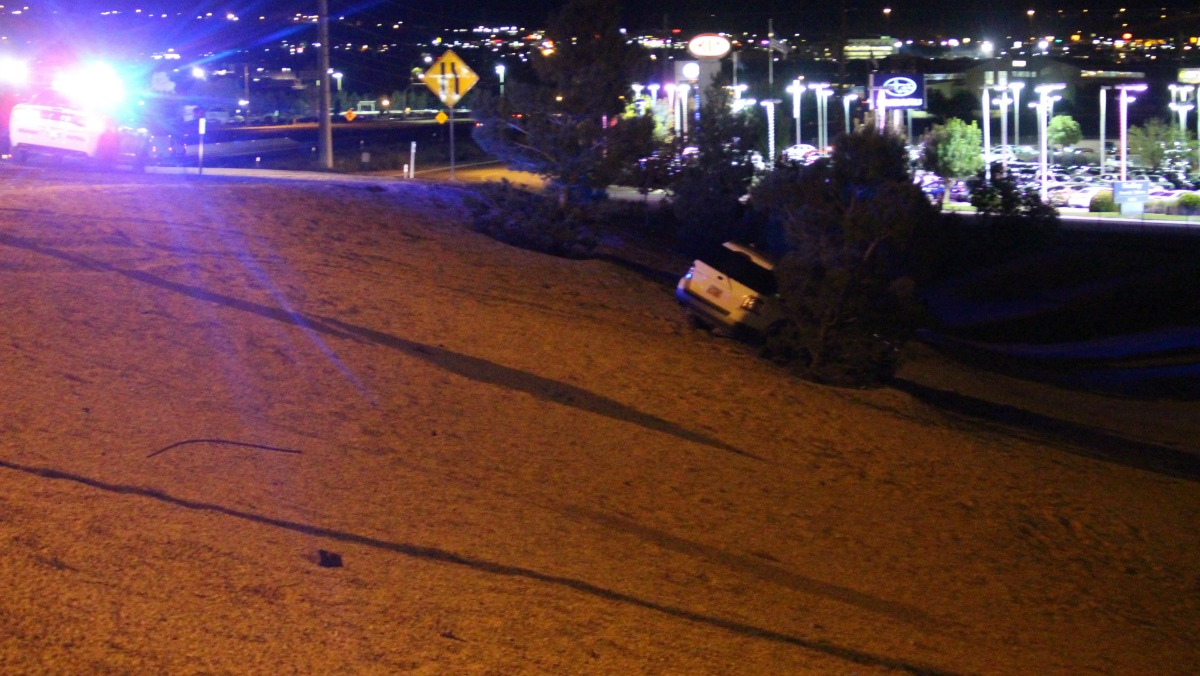 Officers find a white Ford that went 50 feet down an embankment near the Exit 6 on ramp of Interstate 15, St. George, Utah, Sept. 7, 2016 | Photo by Cody Blowers, St. George News