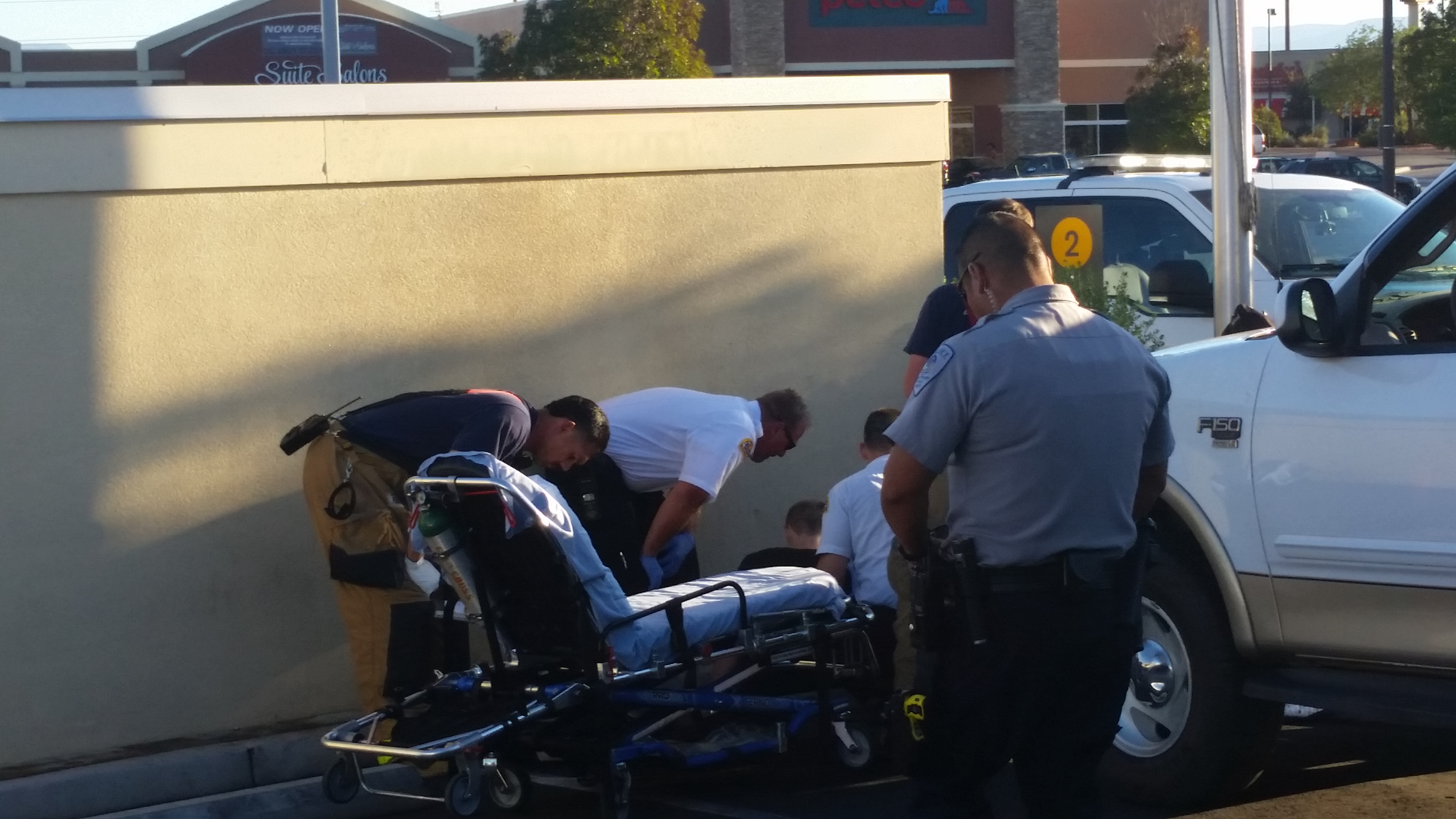 Police and emergency crews respond when a man becomes pinned against wall after reportedly attempting to push his truck, Washington City, Utah, Sept. 26, 2016 | Photo by Brett Barrett, St. George News