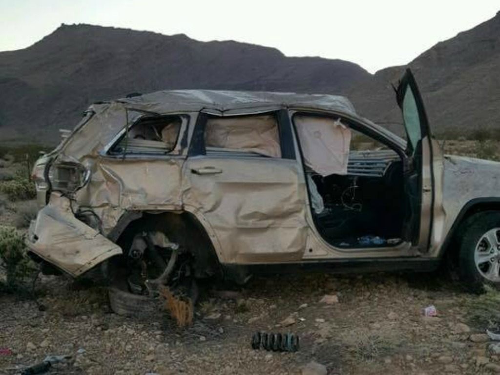 The tan Jeep that was hit and then rolled off to the right of Interstate 15 near mile marker 11 Saturday morning, Mohave County, Ariz., Sept. 24, 2016 | Photo courtesy of Tom Callister, St. George News