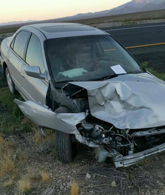 The silver passenger car that struck the Jeep before the driver fled after the crash on Interstate 15 near mile marker 11 Saturday morning, Mohave County, Ariz., Sept. 24, 2016 | Photo courtesy of Tom Callister, St. George News
