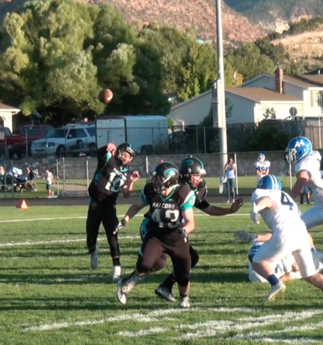 Falcon QB Stockton Rigby passes for a TD Friday night, Dixie at Canyon View, Cedar City, Utah, Sept. 9, 2016   Photo by Dallas Griffin, St. George News