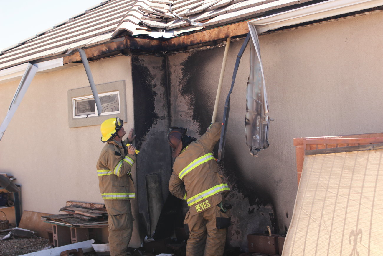 Firefighters respond to a small fire by the side of a home in Washington Fields that is believed to have been triggered by combusting fertilizer, Washington City, Utah, Spt. 14 | Photo by Mori Kessler, St. George News