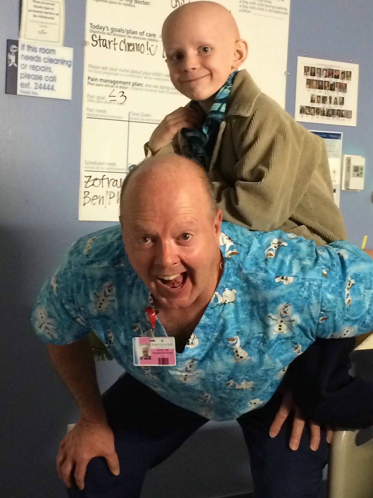 George Stafford hangs out piggyback on a hospital staff member, grinning away. George's treatments were given variously between Dixie Regional Medical Center and Primary Children's Hospital, St. George/Salt Lake City, Utah, circa 2014-15 | Photo courtesy of Travis and Jen Stafford, St. George News
