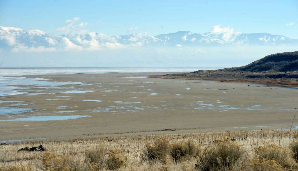 In this Wednesday Jan. 21, 2015, file photo, a view from the shore of Antelope Island looking east toward the Wasatch Mountains shows mudflats that are usually submerged by water of the Great Salt Lake in Utah. More than 100 boats are sitting high and dry in a parking lot on the southern shore of Utah's Great Salt Lake, unable to sail the shallow, drought-stricken sea nearby. The massive lake, key to the Utah's economy and identity, is skirting record low levels after years of below-average participation and record heat   Photo courtesy of Al Hartmann/The Salt Lake Tribune via AP, File, St. George News