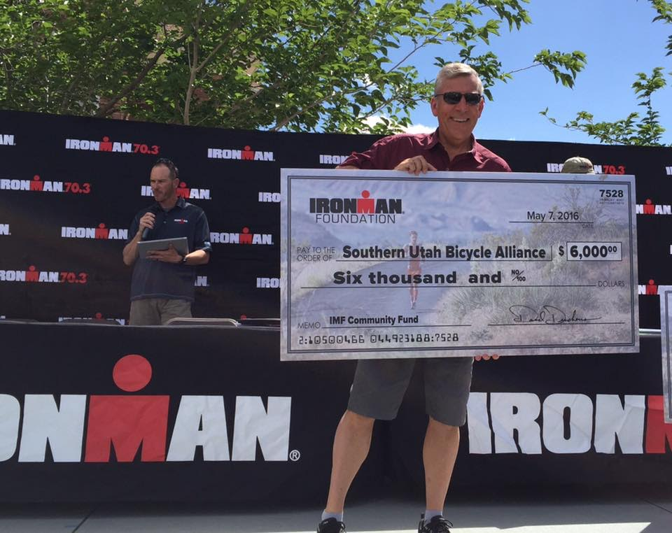 SUBA President Craig Shanklin receiving a second grant from the Ironman Foundation to improve safety for local cyclists, May 2016 | Photo courtesy of The Ironman Foundation, St. George News