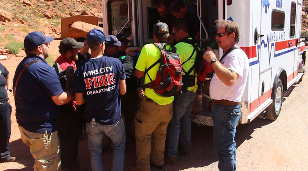Rescuers and first responders load a man into an ambulance after he fell while climbing behind Tuacahn. Ivins, Utah, Sept. 14, 2016 | Photo by Mike Cole, St. George News
