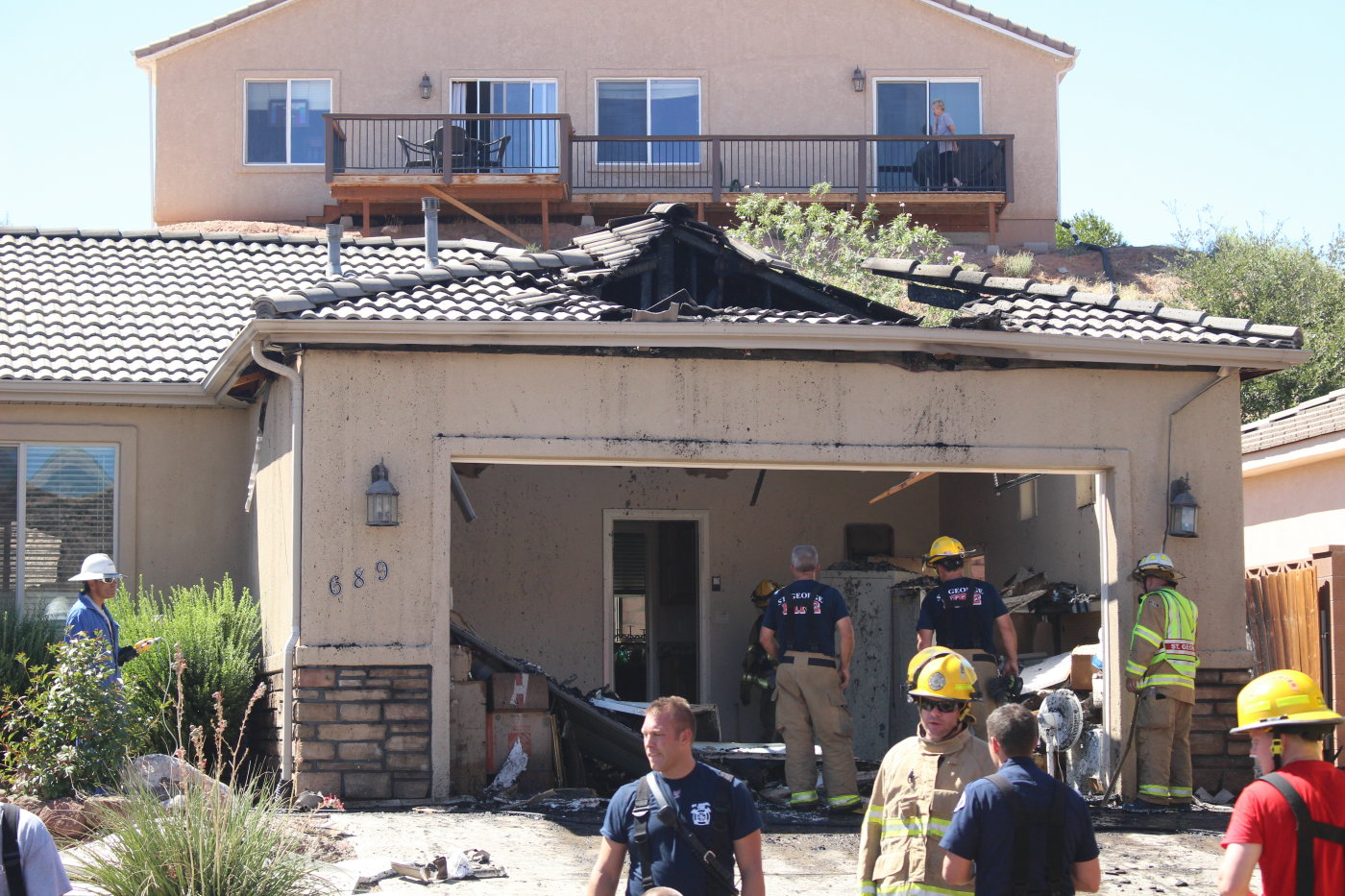 A St. George firefighter was injured when a garage door came down on him during a house fire on Lave Point Drive in St George, Utah, Sept. 19,2016 | Photo by Mori Kessler, St. George