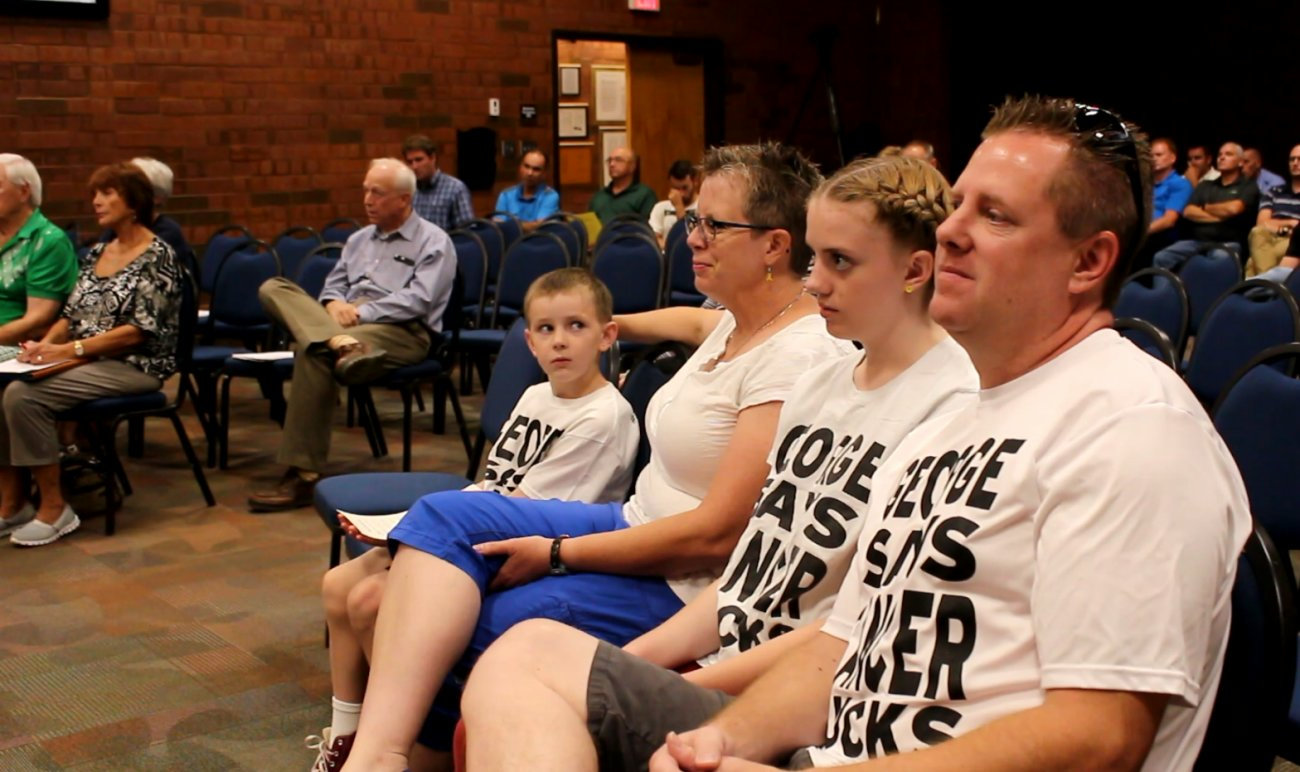 (L-R) George Stafford, his mother Jen Stafford, his older sister, and father Travis Stafford sit on the front row in the council chambers during a meeting of the St. George City Council in which a proclamation of recognizing September as Childhood Cancer Awareness Month is read, St. George, Utah, Sept. 1, 2016 | Photo by Mori Kessler, St. George News