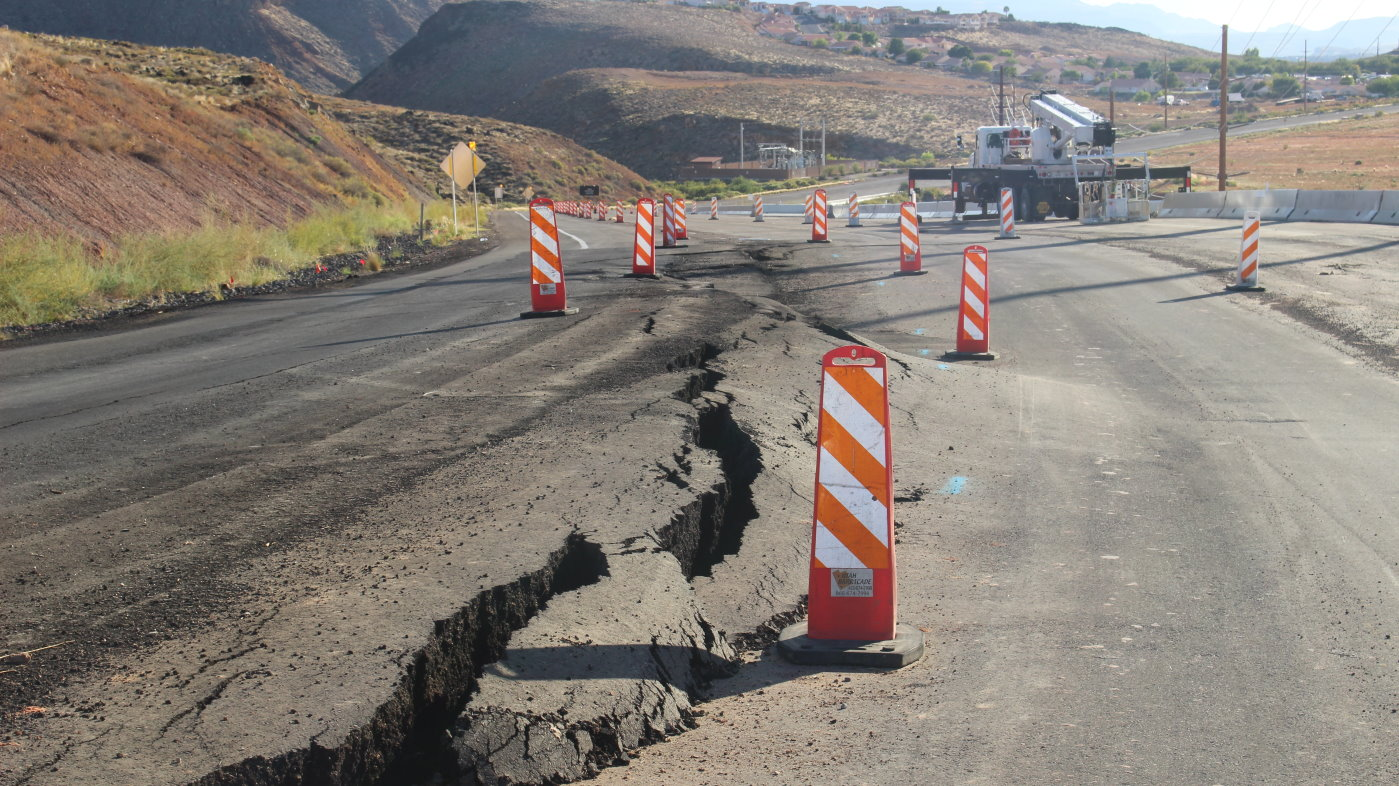Work on creating an earthen buttress designed to counteract a slow-moving slide on hillside between Washington and Highland parkways in Washington City began Tuesday. However, as heavy machinery began to clear the ground at the foot of the hillside, the slide dropped 6 inches, necessitating a closure of a section of Telegraph Street until the hill is considered stabilized by city officials, Washington City, Utah, Sept. 27, 2016 | Photo by Mori Kessler, St. George News