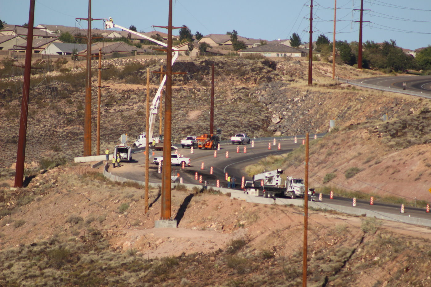 Work on creating an earthen buttress designed to counteract a slow-moving slide on hillside between Washington and Highland parkways in Washington City began Tuesday. However, as heavy machery began to clear the ground at the foot of the hillside, the slide dropped 6 inches, nessitating a closure of a section of Telegraph Street until the hill is considered stabelized by city officials, Washignton City, Utah, Sept. 27, 2016   Photo by Mori Kessler, St. George News