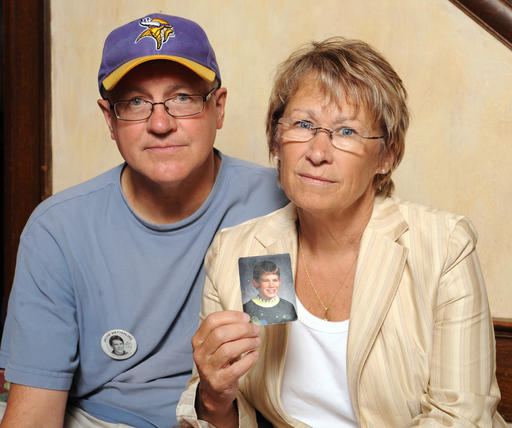 FILE - In this file photo, Patty and Jerry Wetterling show a photo of their son Jacob Wetterling, who was abducted in October of 1989 in St. Joseph, Minn and is still missing, in Minneapolis. Patty Wetterling said Saturday, Sept. 3, 2016 that his remains have been found. Daniel Heinrich, who authorities have called a person of interest in the 1989 kidnapping, denied any involvement and was not charged with that crime. But he has pleaded not guilty to several federal child pornography charges. St. Joseph, Minnesota, Aug. 28, 2009 | Photo by AP Photo/Craig Lassig, File, St. George News