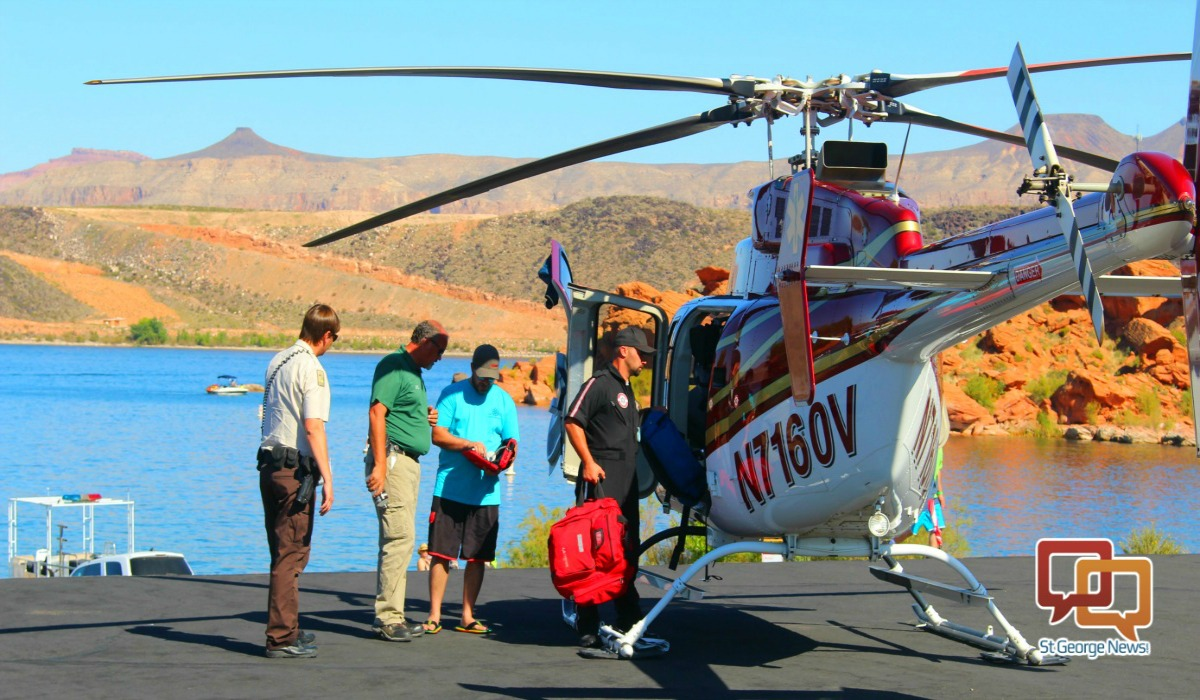 Classic Air Medical helicopter and emergency flight personnel,with park rangers and rescuers at Sand Hollow State Park's main dock at the reservoir Saturday. Hurricane, Utah, Sept. 17, 2016 | Photo by Cody Blowers, St. George News