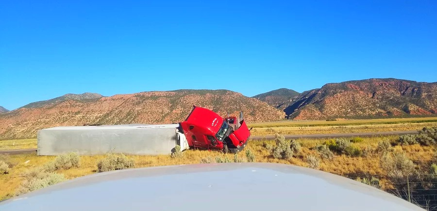Semitrailer that rolled over on Interstate 15 near southbound mile marker 83 in Paragonah Friday, Iron County, Utah, Sept. 9, 2016 | Photo courtesy of Ron Fish, St. George News