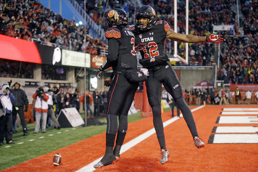 Utah quarterback Troy Williams (3) celebrates with teammate Tim Patrick (12) after scoring against Southern California in the first half during an NCAA college football game Friday, Sept. 23, 2016, in Salt Lake City. (AP Photo/Rick Bowmer)