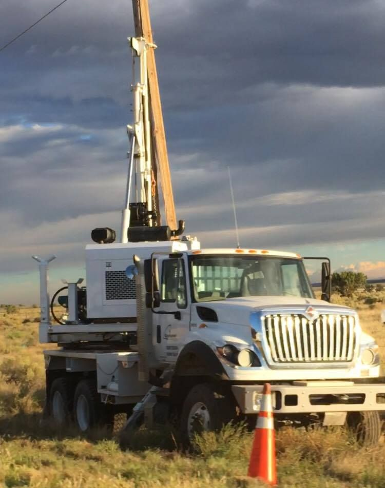 A utility truck works to replace a damaged power pole after a wreck Tuesday afternoon on state Route 59. Hildale, Utah, Sept. 27, 2016 | Photo courtesy of Cody Jessop, St. George News